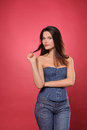 Pretty young woman with slim waist in jean corset Stock Photos