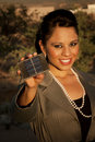 Pretty young woman with small solar panel Royalty Free Stock Photo