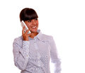 Pretty young woman speaking on cellphone Stock Photography