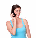 Pretty young woman speaking on cellphone portrait of a in gym clothing against isolated background Royalty Free Stock Photography