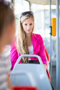 Pretty, young woman on a streetcar/tramway Royalty Free Stock Photography