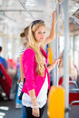 Pretty, young woman on a streetcar/tramway Royalty Free Stock Image