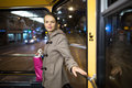Pretty young woman on a streetcar tramway during her evening commute home from work color toned image shallow dof Royalty Free Stock Image