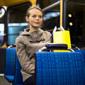 Pretty young woman on a streetcar tramway during her evening commute home from work color toned image shallow dof Royalty Free Stock Images