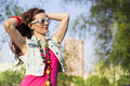 Pretty young woman in sunglasses on the natural background Royalty Free Stock Photography
