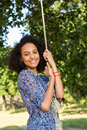 Pretty young woman in swing Royalty Free Stock Photo