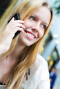 Pretty young woman talking on the smartphone blonde Royalty Free Stock Photo