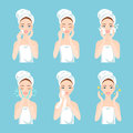 Pretty young woman with a towel around her head and body remove make-up, clean, wash and care her face with sponge.