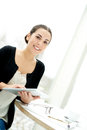 Pretty young woman using a handheld tablet Royalty Free Stock Photo