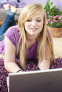 Pretty young woman using laptop Royalty Free Stock Image