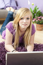 Pretty young woman using laptop Stock Photos