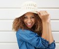 Pretty young woman wearing summer hat and laughing close up portrait of a Stock Photos
