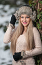 Pretty young woman in a winter fashion shoot Stock Photography