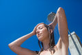 Pretty, young woman woman under shower on the beach Royalty Free Stock Photo