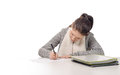 Pretty young woman writing on her desk Royalty Free Stock Photo