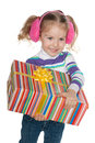 Prettyl little girl with a gift box holds on the white background Royalty Free Stock Photos