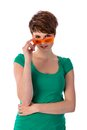 Pretyy young woman looking over her sunglasses pretty orange Royalty Free Stock Images