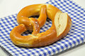 Pretzel on blue and white checkered Napkin Stock Images