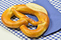 Pretzel on blue and white checkered Napkin Royalty Free Stock Images