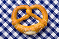 Pretzel on checkered napkin Royalty Free Stock Images