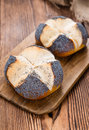 Pretzel roll with poppyseed fresh baked close up shot Stock Images