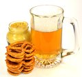 Pretzels beer and mustard a stack of with a jar of a glass of Royalty Free Stock Image