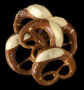 Pretzels some german baked bread products named pretzel in black back Stock Images