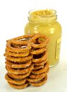 Pretzels a stack of with a jar of mustard Royalty Free Stock Photography