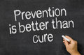 Prevention is better than cure blackboard with the text Stock Photo