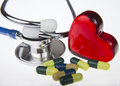 Preventive medical stethoscope with pills and red heart Stock Photos