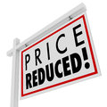 Price reduced home for sale sign lower value words on a to illustrate a owner in distress and needing to sell immediately as a Royalty Free Stock Images