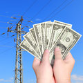 Prices raise hands keep banknotes dollars on an electricity pillar background Royalty Free Stock Photo
