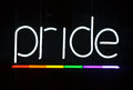 Pride sign a white neon with a rainbow underscore Stock Image
