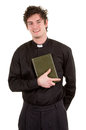Priest with a bible Stock Photos