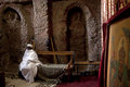 Priest sat in a monolithic church lalibela Stock Photography