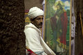 Priest sat in a monolithic church lalibela Stock Photo