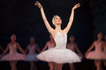 Prima ballerina white swan on stage dancing gracefully against other dancers ballet lake the opera house in kiev ukraine Stock Photography