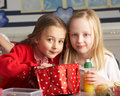 Primary School Pupils Enjoying Packed Lunch In Cla Stock Images