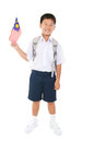 Primary school student holding malaysia flag Stock Photography