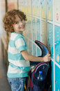 The primary school students standing near lockers in hallway Royalty Free Stock Photo