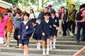 Primary school students wearing school uniforms