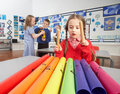 Primary Schoolchildren Having Music Lesson Royalty Free Stock Images
