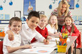 Primary Schoolchildren And Teacher Working Royalty Free Stock Photos
