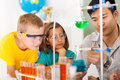 Primary science class students in with teacher Stock Photo
