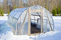 Primitive handmade greenhouse in winter time on snow Royalty Free Stock Photos