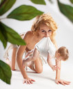 Primitive woman carrying baby Stock Photography