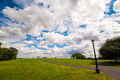 Primrose hill in london on a beautiful day with clouds the clouds seemed to be caught the hand Royalty Free Stock Images
