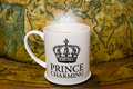 Prince charming cup of tea Stock Photos