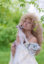 Princess and cat in her hands looking up together Royalty Free Stock Image
