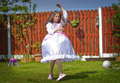 Princess dance little girl wearing a dress is dancing in the garden Royalty Free Stock Photo